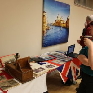 Martha VA3SBD checks out the old amateur radio equipment and looks at historical pictures from the presentation