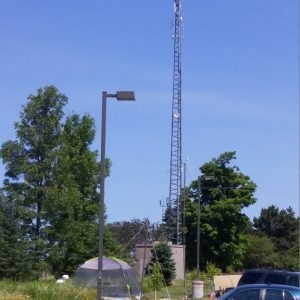 A shot of our repeater tower behind Clint and Martha's station at Field Day 2016.