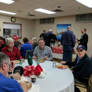Two of our North Shore Amateur Radio Club members sit around a table, about to dig into the tasty food during our Christmas Potluck dinner in December 2016. On the left is Lex (VE3LEX) and on the right is Dave (VA3RLP).