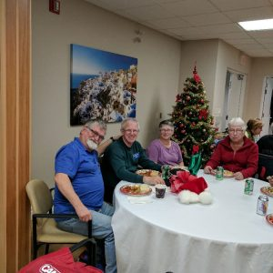 Two of our North Shore Amateur Radio Club members sit around a table and pose for a photo together before taking a bite to eat during our Christmas Potluck in December 2016. On the left is Scott (VE3RPN). On the right is Peter (VE3PWJ).