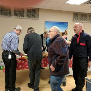 A group of our North Shore Amateur Radio Club members line up to get a plate of food during our Christmas Potluck in December 2016. From left to right we have Ken (VE3RMK), Lee, Bob (VE3IRB), Gerard (VE3CWR), Mike's wife, Larry (VA3FHG), and Tom (VA3TGW).