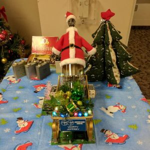 A photograph of centrepiece made out of a radio tube, dressed as Santa Claus and places in a sled for our Christmas Potluck in December 2016. This was made by our club member Jeffrey (VA3RTV).