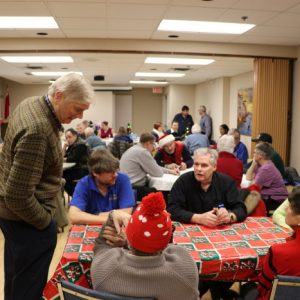 A photograph of our club members having dinner and chatting during our Christmas Potluck in December 2016.