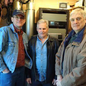 Lex VE3LEX, Jeffrey VA3RTV, and Bob VE3HIX pose in front of the new Yaesu Fusion Repeaters