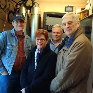 Lex VE3LEX, Colleen, Jeffrey VA3RTV, and Bob VE3HIX pose in front of the new Yaesu Fusion Repeaters