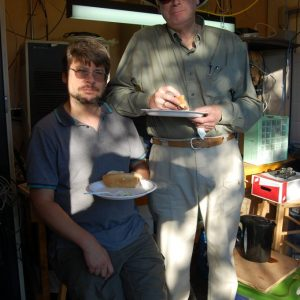 Clint VA3KDK and Bob VE3HIX have a bite to eat while sitting in the Repeater Shack for some shade