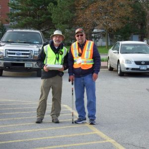 Larry VA3FHG and Doug VA3DCE manning the parking lot to help vendors arrive and unload.