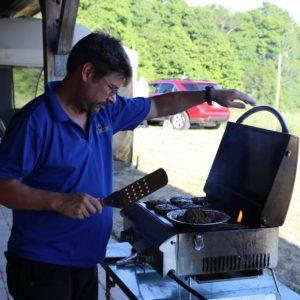 Clint VA3KDK prepares meals for everyone