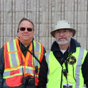 Joe VE3VGJ and Larry VA3FHG take a quick break from helping vendors park to pose together