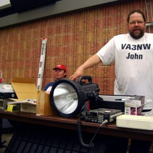 John VA3NW poses with his giant flashlight. He managed to sell this big guy maybe 15 minutes after this picture!