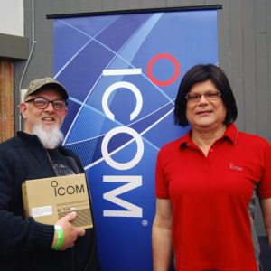 Rob VE3UZL poses with Rose from Icom Canada after he wins our door prize draw for a new Icom ID-51A radio