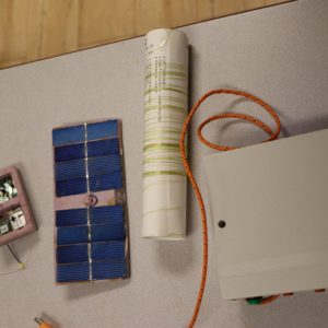 An overhead shot of David's GPS tracking/radio beacon device, the power supply, and his antenna