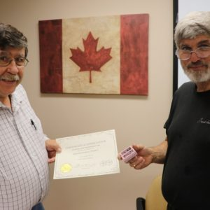 Steve VA3TPS presents David VE3KCL with a Certificate of Appreciation from our North Shore members