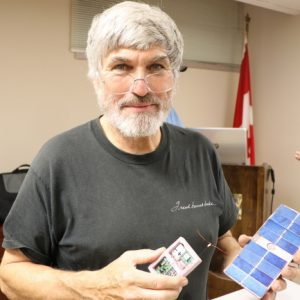David Beverstein VE3KCL poses with his GPS tracker/radio beacon and it's power supply