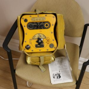 This radio is an emergency radio for paratroopers and emergency rafts. When someone turns the crank on the front, it powers an SOS CW beacon.
