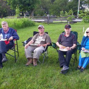 Bob VE3HIX, Ralph VE3CRK, Scott VE3SCO, Jeffrey VA3RTV and June sit enjoying the food.