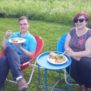 Alex VE3ZSH and Sabrina VA3AXU sit in their low ride chairs enjoying the food.