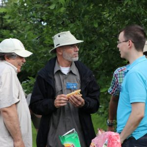 Steve VA3TPS, Larry VA3FHG and Alex VE3ZSH take some time to talk during the BBQ.