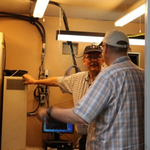 Lex VE3LEX and Laird VE3LKS talk about our repeater in the shack while staying out of the rain storm.