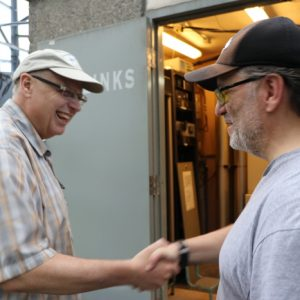 Laird VE3LKS gives a smile and a friendly handshake to one of our visitors during the BBQ.