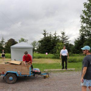It's a busy afternoon! Alex VE3ZSH, Sabrina VA3AXU, Clint VA3KDK, Mike VA3MCX and Barry help to set up.