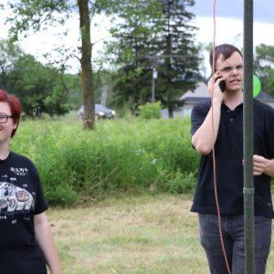 Sabrina VA3AXU and Alex VE3ZSH help set up.