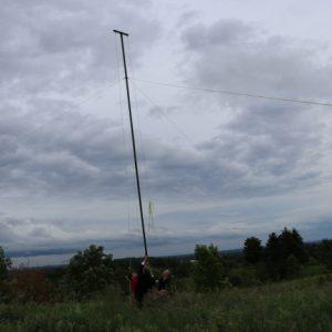 Clint VA3KDK, Bob VE3IRB, Mike VA3MCX and Michel VA3HEM work together to get that antenna up!