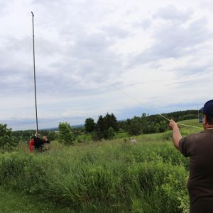 Steve VA3TPS helps hold up the antenna while the others keep it steady!