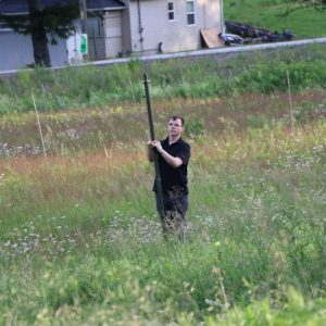 Alex VE3ZSH stands out in some of the Purple Woods fields to help set up an antenna.