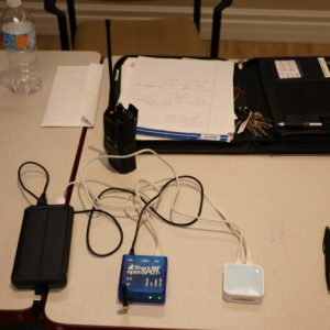 Steve VA3TPS brought in his gear for the presentation on DMR radio. Steve brought in his phone (left), which is connected to a modem (right) and an Ethernet cable which goes to a SharkRF (center).